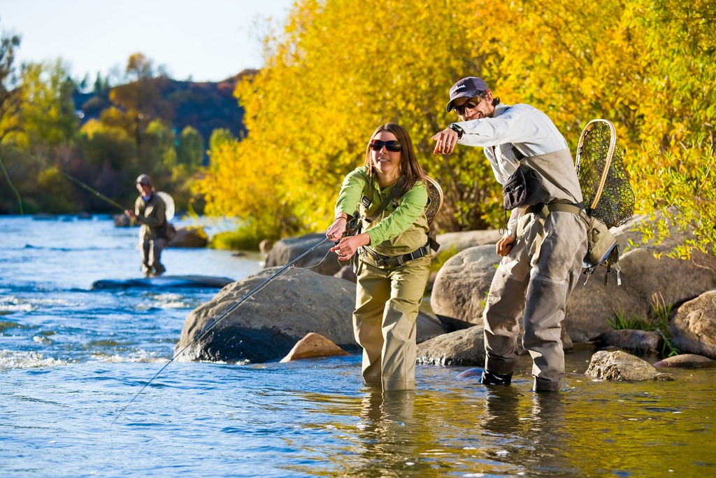 three people Fly Fishing the Yampa River
