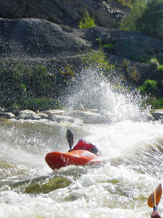 one Kayaker in rapids water in the yampa river